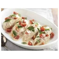 Chicken in Creamy Pan Sauce Recipe - Chicken breasts simmered in a creamy sauce make an easy but elegant dinner.