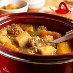 Slow Cooker Fall Harvest Pork Stew Recipe - Slow cooking ensures meltingly tender results in this rich and satisfying pork stew packed with apples, butternut squash and parsnips . . . it's delish!