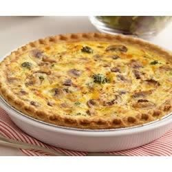 Broccoli and Cheddar Quiche Recipe - Lots of shredded cheese and crisp-tender vegetables baked in a deep dish pie shell make this a great quiche for a special brunch.
