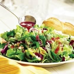 Strawberry Vinaigrette Salad Recipe - Strawberry preserves add fruit and flavor to a lemon vinaigrette in this fresh green salad with almonds, green onions, and blue cheese.