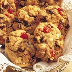 Black Forest Oatmeal Cookies Recipe - Oatmeal cookies are made extra-special with the addition of chocolate chunks, cherries, and sliced almonds.