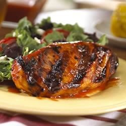Campbell's(R) Southern-Style Barbecued Chicken Recipe - Chicken on the grill is basted with a honey-and-mustard kissed tomato sauce.