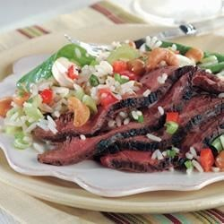 Teriyaki Steak Recipe - Strips of skirt steak are marinated overnight with teriyaki sauce and garlic, then broiled or grilled for about 10 minutes.
