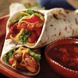 California Chicken Salad Tacos Recipe - Fresh Western flavors of Pace(R) Picante Sauce, lime juice and chili powder season strips of chicken to fold inside a tortilla with crisp lettuce, shredded cheese and chopped tomato.
