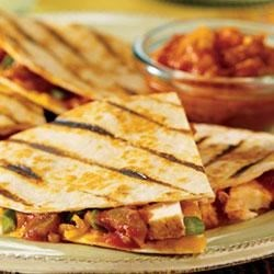 Pace(R) Spicy Grilled Quesadillas Recipe - Tender chicken, green onion, Pace(R) Thick & Chunky Salsa and Cheddar cheese are sandwiched in flour tortillas that are grilled until golden.