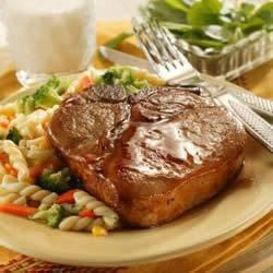 Honey-Glazed Pork Chops Recipe - A basic glaze for an easy dinner. Serve with favorite pasta and steamed vegetables.