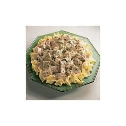 Campbell's Kitchen Beef Stroganoff Recipe - Always a family favorite, this classic dish of quickly sauteed beef and onion in a creamy mushroom sauce is perfect over hot cooked noodles. Garnish with fresh parsley for a colorful table presence and serve with a family favorite green vegetable.
