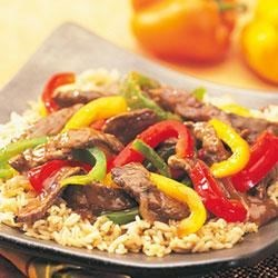 Swanson(R) Steakhouse Beef and Pepper Stir-Fry Recipe - Crisp and colorful peppers, strips of beef tenderloin and a perfectly seasoned sauce make this simple stir-fry speedier and tastier than take-out.