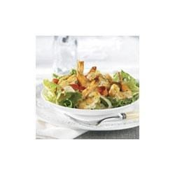 Margarita Shrimp Salad Recipe - Tender shrimp are marinated in lime and garlic, cooked in Swanson(R) Chicken Broth with orange peppers, onion and cilantro, and served over lettuce and tomato to make a delightful salad.