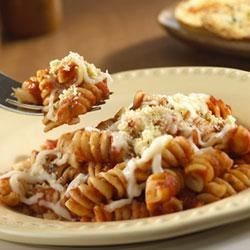 2-Step Cheesy Pasta Twists Recipe - Corkscrew pasta, Prego(R) Pasta Sauce and mozzarella cheese make an easy-and-delicious casserole topped with crunchy croutons.