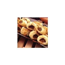 Sausage and Parmesan Puffs Recipe - Savory sausage enclosed in golden, buttery puff pastry makes a delicious appetizer your guests will love.