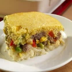 Sausage Corn Bread Bake Recipe - A layer of hash brown potatoes, then creamy corn and sausage, topped with a layer of corn bread makes a hearty breakfast to start your family's day.