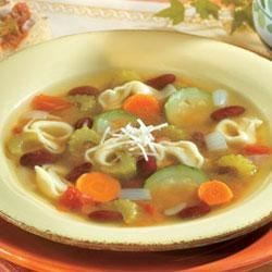Italian Tortellini Soup Recipe - This hearty pasta and bean soup features cheese-filled tortellini, zucchini, tomatoes and other vegetables simmered in chicken broth.