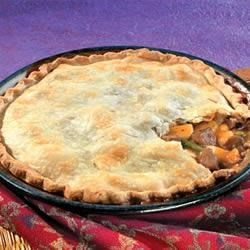 Easy Beef Pot Pie Recipe - Convenient cooked beef and vegetables bound with a creamy mushroom gravy are tucked into a flaky pie crust.