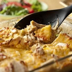 Slow Cooker Cheesy Chicken and Tortillas Recipe - Slow cooking the chicken before shredding makes it especially tender and flavorful...when that chicken is layered with tortillas and cheese, you've got a simple, family-friendly casserole.