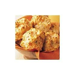 Cheddar and Roasted Garlic Biscuits Recipe - Simply stir Swanson(R) Seasoned Chicken Broth with Roasted Garlic into baking mix along with shredded Cheddar cheese for flavorful, flaky biscuits every time.