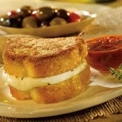 Fresco's Best Italian Cheese Sandwich Recipe - Sandwiches made with fresh mozzarella and Pepperidge Farm(R) Garlic Texas Toast are given a crispy coating and pan-fried until golden. Serve with a mixed green salad with apricots, strawberries, and toasted walnuts with a strawberry vinaigrette. For dessert serve chocolate cupcakes with vanilla frosting.