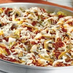 Pasta Pizza Pie Recipe - Tri-colored corkscrew pasta creates a bottom crust to top with Prego(R) Traditional Italian Sauce, a savory mushroom-onion saute and mozzarella cheese.