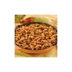 Beefy Pasta Skillet Recipe - This dish features ground beef and onion simmering with tomato, pasta and cheese.