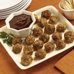 Wildfire Sausage Meatballs Recipe - Served with barbecue sauce, these baked sausage balls are the perfect party treat. They're great served on a hoagie roll, too!
