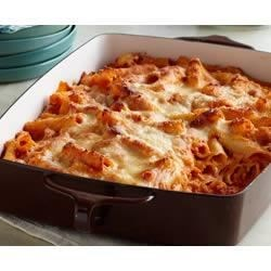 Creamy Baked Ziti Recipe - Ziti pasta with a creamy tomato sauce is layered with shredded mozzarella cheese then topped with more mozzarella and grated Parmesan--a cheese lover's dream!