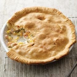 Creamy Chicken Pot Pie Recipe - This version of the comfort food classic combines boneless chicken and mixed vegetables in PHILADELPHIA Savory Garlic Cooking Creme, all baked in a flaky pie crust.