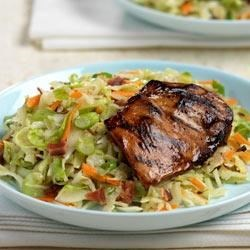 Grilled Chicken with Wilted Slaw Recipe - Molasses-marinated chicken thighs are grilled to perfection, then served with a bacony wilted slaw.