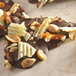Dark Chocolate Bark Recipe - Salty pretzels, potato chips, and peanuts are covered with NESTLE(R) TOLL HOUSE(R) Dark Chocolate Morsels in this sweet and salty snack.