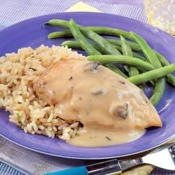 Creamy Mushroom-Garlic Chicken Recipe - A garlic and mushroom sauce gives sauteed chicken breasts a dressed-up touch, perfect to pair with rice and your favorite green vegetable.