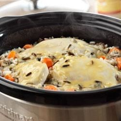 Creamy Chicken and Wild Rice Recipe - Boneless chicken breasts, carrots and wild rice mix simmer to tenderness in a creamy chicken gravy.