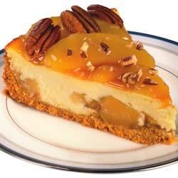 Caramel Apple Cheesecake Recipe - Apple pie filling and melted caramel topping are a sublime variation to cheesecake.