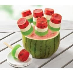 Watermelon Pops Recipe - Layers of raspberry, cream cheese and lime look like watermelon slices with chocolate chip 'seeds' in these tasty frozen pops.