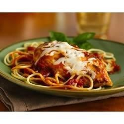 Chicken Italian Recipe - Browned chicken breasts are simmered in a savory tomato base with herbs and cheese, then served with piping hot spaghetti for a quick, easy dinner.