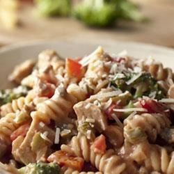 Southwest Chicken and Pasta Recipe - Colorful and full of flavor, this one-pot supper features broccoli, green pepper, chunks of chicken and corkscrew pasta simmered in a creamy sauce spiked with Pace(R) Picante. Fast, easy and satisfying, this dish is sure to become a favorite.