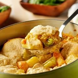 Campbell's(R) Slow-Cooker Chicken and Dumplings Recipe - The slow-cooker simmers chicken, potatoes, carrots, and celery in a creamy sauce made with Campbell's(R) Condensed Cream of Chicken Soup, to be topped with tender dumplings made easy with baking mix.