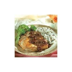 Pork Chops with Cranberry Balsamic Sauce Recipe - Seasoned pork chops are cooked just until tender, and served with a tangy dried cranberry and vinegar sauce made special with Swanson(R) Chicken Stock.