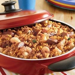Pre-Game Paella Recipe - Chicken, kielbasa and shrimp are mixed with a bold combination of Swanson(R) Chicken Stock, rice, turmeric and salsa to make a colorful dish that's a real crowd pleaser.