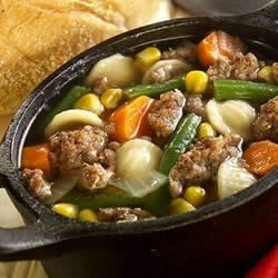 "Savory Sage Sausage and Vegetable ""Stoup"" Recipe - Heartier than soup but not quite a stew, this rich, slow-cooked 'stoup' is loaded with fresh veggies, sausage, and pasta in a savory herb and chicken broth."