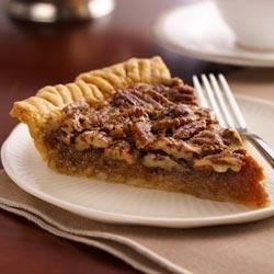 Golden Pecan Pie Recipe - A classic pecan pie with lots of pecans is nestled in a brown sugar custard and baked in a flaky pastry. Mmm!