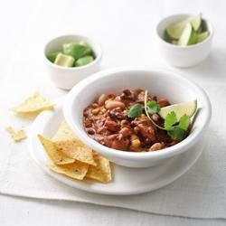 Chicken, Veggie and Two-Bean Chili Recipe - A new twist on a traditional family favourite! A complete meal in a bowl ready in minutes that features chicken and the any day magic of cream.