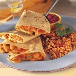 Chicken Quesadillas and Fiesta Rice Recipe - A spicy, creamy chicken mixture fills crispy-baked tortillas, cut into wedges and served with Mexican-flavored rice.
