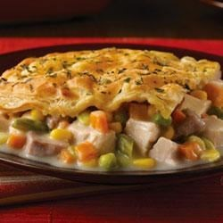 Savory Herb-Crusted Chicken Pot Pie Recipe - Tender chicken and mixed vegetables are bathed in gravy made with Swanson(R) Chicken Broth, then topped with a Pepperidge Farm(R) Puff Pastry crust that has been dusted with chopped fresh herbs.
