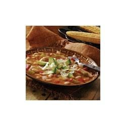 Kickin' Coyote Chili Recipe - This smoky chili combines cooked chicken, onion, celery, red pepper, salsa, white Northern beans and Swanson(R) chicken broth and is garnished with avocado and shredded Monterey Jack cheese.