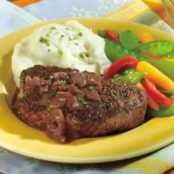 Peppercorn-Seasoned Steaks with Mustard-Wine Sauce Recipe - This is the perfect main dish for a special evening. Tenderloin steaks are seasoned with pepper, pan seared and served with a fresh and savory mustard-wine sauce.