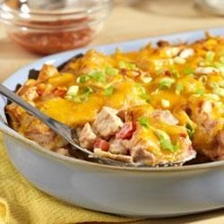 Campbell's Kitchen King Ranch Casserole Recipe - Corn tortilla strips are layered with a delectable combination of Campbell's(R) Condensed Cream of Mushroom Soup, Pace(R) Picante Sauce, sour cream, tomatoes and chicken, sprinkled with cheese, baked and served with additional picante sauce and sour cream.