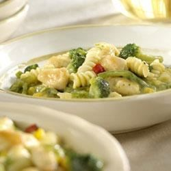 2-Step Creamy Chicken and Pasta Recipe - Frozen vegetable and pasta blends are a great time saver, rounding out this dish into a one dish meal. Choose your favorite cream soup to create the creamy sauce!