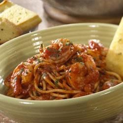 Roasted Garlic and Herb Shrimp with Spaghetti Recipe - Spaghetti and shrimp are tossed with a spicy red sauce made with Prego(R) Roasted Garlic and Herb Italian Sauce, garlic and crushed red pepper. This recipe pairs perfectly with crisp Pepperidge Farm(R) Garlic Bread.  Begin the meal with a vegetable antipasto.  For dessert serve a strawberry napoleon.