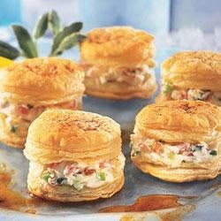 Crab Appetizer Napoleons Recipe - The crabmeat/cream cheese filling in these Napoleons is flavored with a bit of horseradish. Sliced green onions and almonds add both crunch and color.