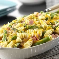 Ham Asparagus Gratin Recipe - Ham, cheese and asparagus are baked together with seasonings and corkscrew pasta in a cheesy sauce made with Campbell's(R) Condensed Cream of Asparagus Soup.