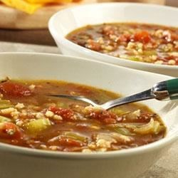 Swanson(R) Roasted Tomato and Barley Soup Recipe - Roasted tomatoes, onion and garlic simmer together with tender barley, celery and Swanson(R) Chicken Broth to make a robust, rustic-style soup.